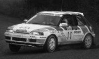 Mazda 323 GTX, No.11, 1000 Lakes Rallye, with night lights, H.Mikkola/A.Hertz, 1990